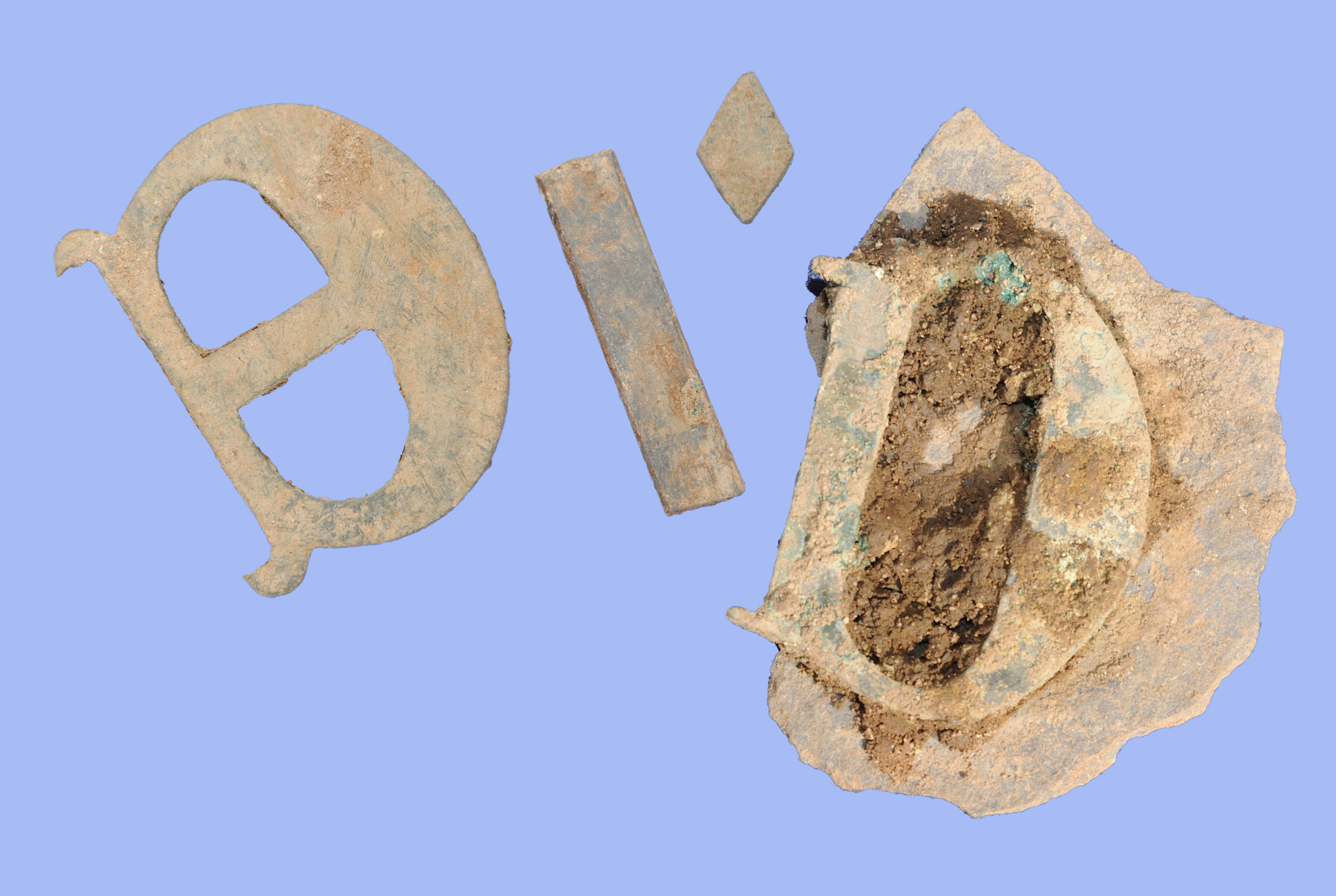Copper alloy letters found on the site, perhaps from tomb inscriptions (Credit - University of Leicester)